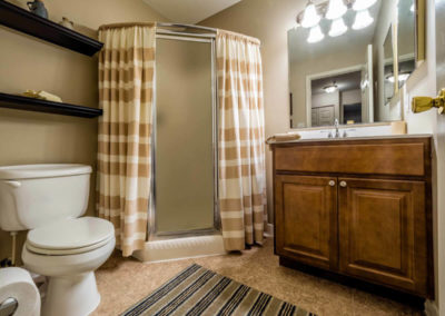 Cozy guest bathroom with toilet and glass showers in Pointe North apartment rentals in Bethlehem, PA