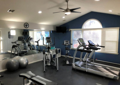 Lovely gym with treadmills and exercise machineries in Pointe North apartments in Bethlehem, PA