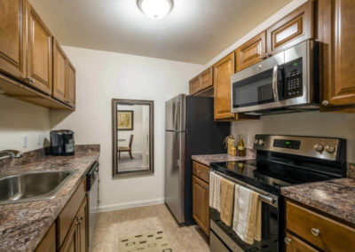 Pointe North apartment rental with wooden cabinetry in spacious kitchen in Bethlehem, PA